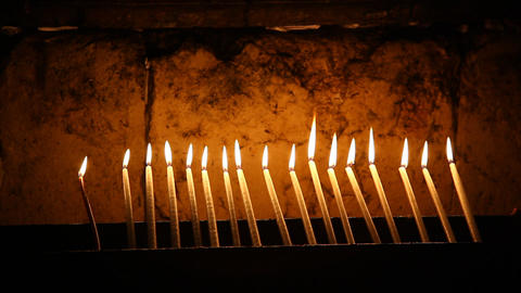 Christian Pilgrims Light Candles In The Church Of  stock footage