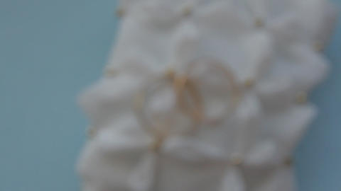 Wedding rinds on white pillow Footage