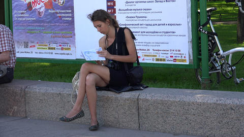 Girl tourist studying a map of the city. 4K Footage