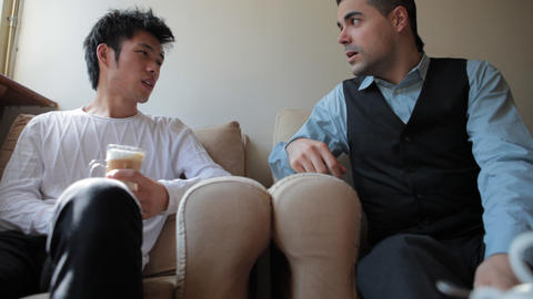 Young Chinese and Italian Men Friends Chatting Footage