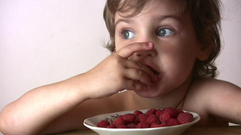 little girl with raspberry Footage