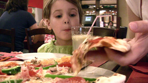 Mother with girl and pizza Footage