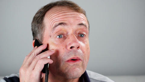 Adult Male Talking On A Mobile Phone - Close Up stock footage