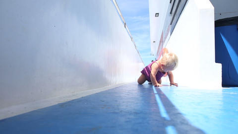 Girl Crawling On Deck stock footage