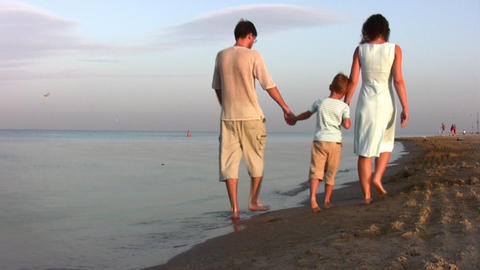 Walking Family With Boy On Beach stock footage