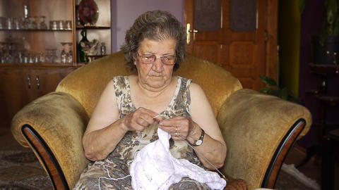 Old retired woman knitting in home Footage