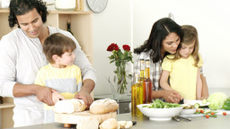 Happy Family Preparing A Meal In The Kitchen stock footage