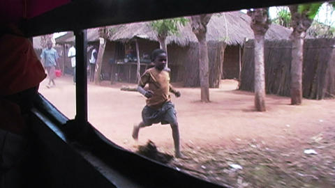 0883 Children In Africa Running After Car And Say stock footage