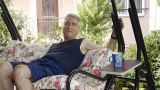 Old Retired Man On Porch Swing - Leisure stock footage