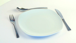 Plate, Fork, Knife And Spoon Turning stock footage