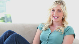 Woman Changes Of Channel And Laughs stock footage