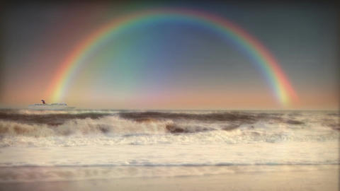 (1200) Full Rainbow Sky Ocean Surf Waves Beach Sunset Cruise Ship LOOP stock footage