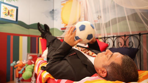 Mature man wearing suit playing with ball Footage