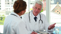 Doctor Talking With A Young Female Doctor stock footage