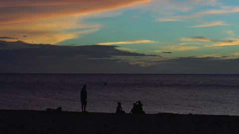 Silhouettes Of People On The Beach During Sunset stock footage