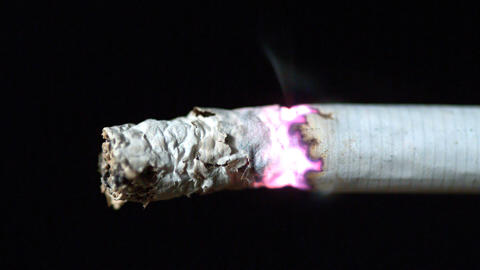 Cigarette Burning On Black Background Close Up stock footage