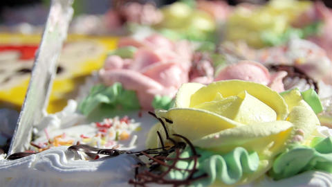 Slicing A Cake With Flower Designs stock footage