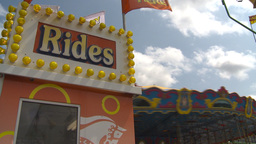 HD2009-7-3-17b Midway Rides Kids 3shot stock footage