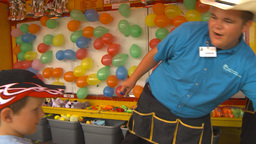 HD2009-7-3-29 Midway Balloon Popping Happy Kid stock footage