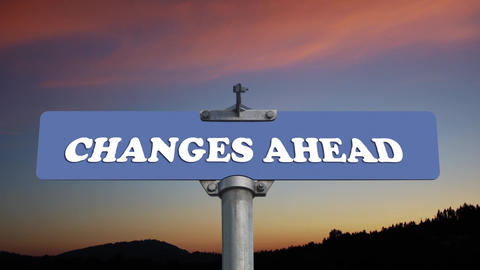 Changes Ahead Road Sign With Flowing Clouds stock footage