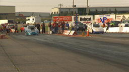 HD2009-6-22-47 Motorsports, Drag Racing Top Alcohol Funny Car Race Close Call stock footage