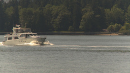 HD2009-6-31-3 Pleasure Boat And Zoom Back Skyline stock footage