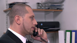 Man Not Happy With Business Call At Work stock footage