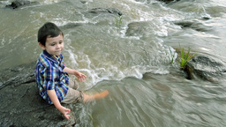 Child Having Fun At The Riverside stock footage