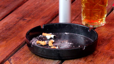 Ashtray With Cigarette Butts And A Pint Of Beer stock footage