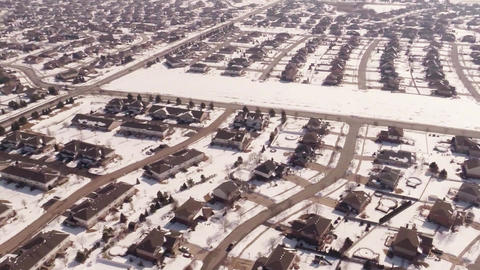 Aerial Of Homes In A Snow Covered Suburban Neighbo stock footage