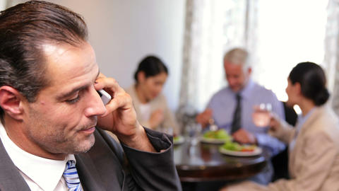 Businessman Talking On Phone At Business Lunch stock footage