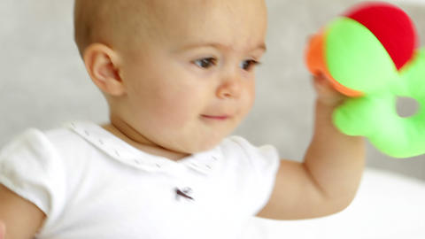 Cute Baby Girl Playing With Soft Ball On Bed stock footage