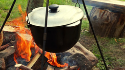 Cooking On The Campfire stock footage