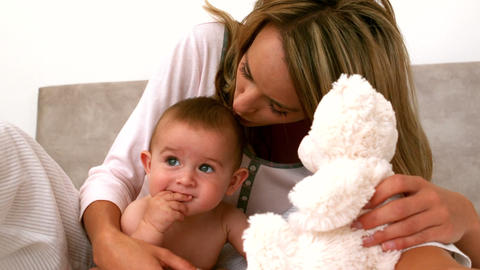 Cute Baby On A Bed With Mother stock footage