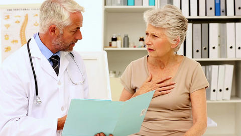 Doctor Explaining An Illness To Patient stock footage