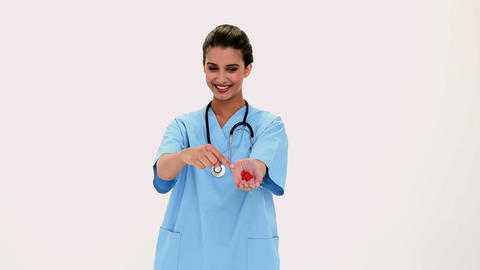 Content Beautiful Nurse Showing Red Pills In Her H stock footage