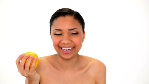Cute Laughing Woman Holding Orange stock footage