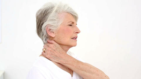 Injured Patient Rubbing Her Neck stock footage