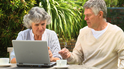 Mature couple using a laptop Footage