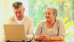 Retired Couple Using A Laptop stock footage