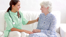Elderly Woman Speaking With Home Nurse stock footage