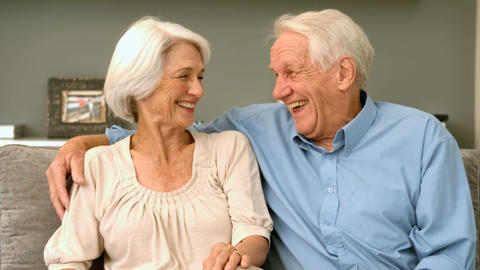 Elderly Couple Laughing At Home stock footage