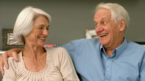 Elderly Couple Laughing In Their Home stock footage