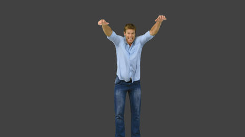 Man Jumping To Show His Triumph On Grey Screen stock footage