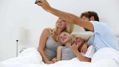 Father Taking Self Portrait Of Him With Happy Fami stock footage