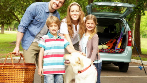 Parents Posing With Children And Pet Dog In The Pa stock footage