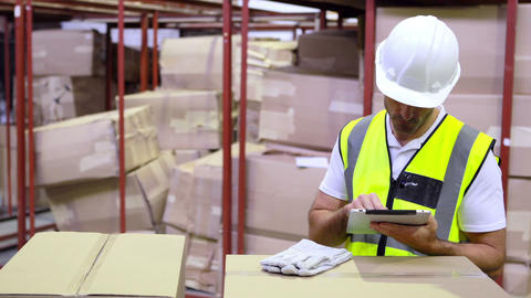 Warehouse Worker Checking Boxes For Shipping With  stock footage