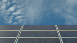 Time Lapse Of Clouds Moving Past Solar Panels stock footage