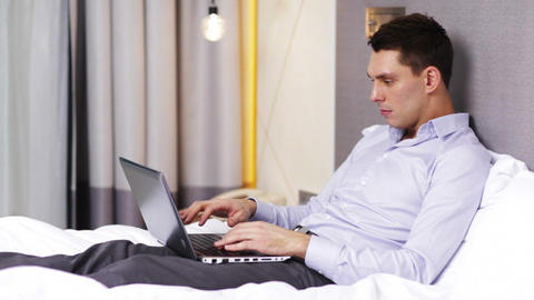 Businessman Working With Laptop Computer In Hotel stock footage