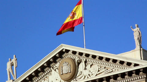 Flag of spain on top of building Footage